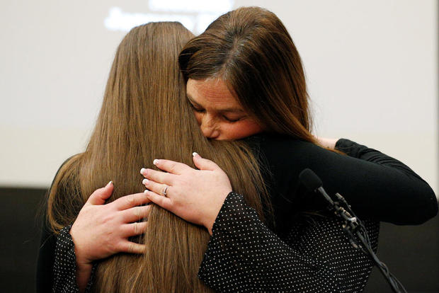 Victim Emma Ann Miller is embraced by her mother Leslie Miller at the sentencing hearing for Larry Nassar, a former team USA Gymnastics doctor who pleaded guilty in November 2017 to sexual assault charges, in Lansing