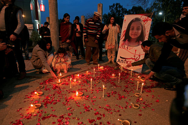 FILE PHOTO: Members of Civil Society light candles and earthen lamps to condemn the rape and murder of 7-year-old girl Zainab Ansari in Kasur, during a candlelight vigil in Islamabad