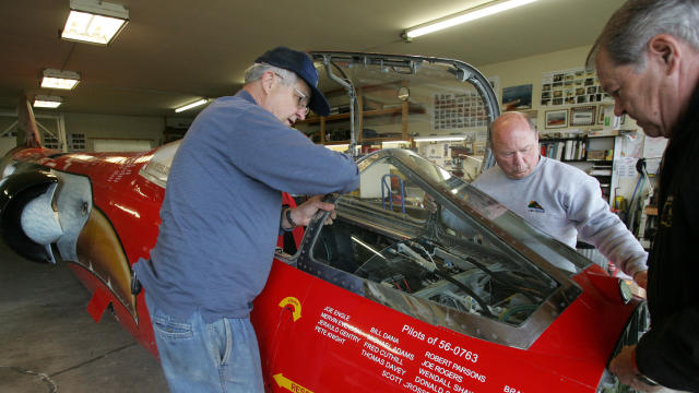 From left, Von Armstrong, Richard Pengelley and Ed Shadle set the windshield down onto the front of the North American Eagle jet-powered vehicle May 3, 2008, in Spanaway, Wash. A handful of Snohomish County residents are part of a team of airplane mechanics, speed junkies and military veterans who are converting a 1960s-era F-104 Starfighter into a supersonic driving machine.