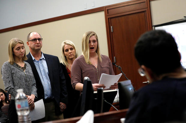 Victims and former gymnasts Maddie and Kara Johnson speak alongside their parents Brad and Kelly Johnson at the sentencing hearing for Larry Nassar, in Lansing