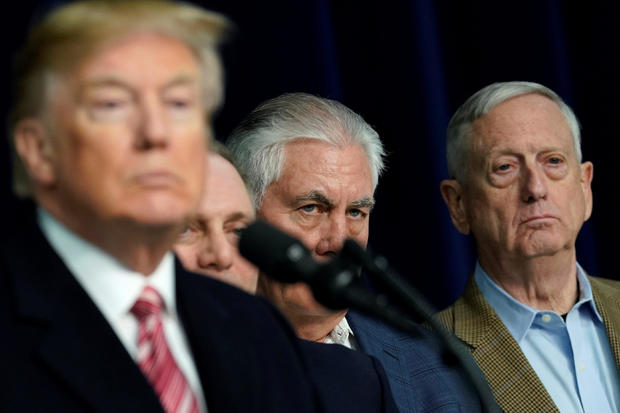 Secretary of State Rex Tillerson listens to President Donald Trump