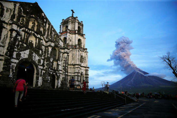 A view of Mount Mayon volcano as it erupted anew, from Our Lady of the Gate Parish church in Daraga, Albay province, south of Manila