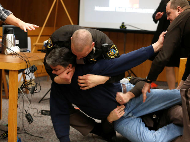 Eaton County sheriff's deputies restrain Randall Margraves after he lunged at Larry Nassar, a former USA Gymnastics team doctor who pleaded guilty in November 2017 to sexual assault charges, during victim statements in his final sentencing hearing in Eato