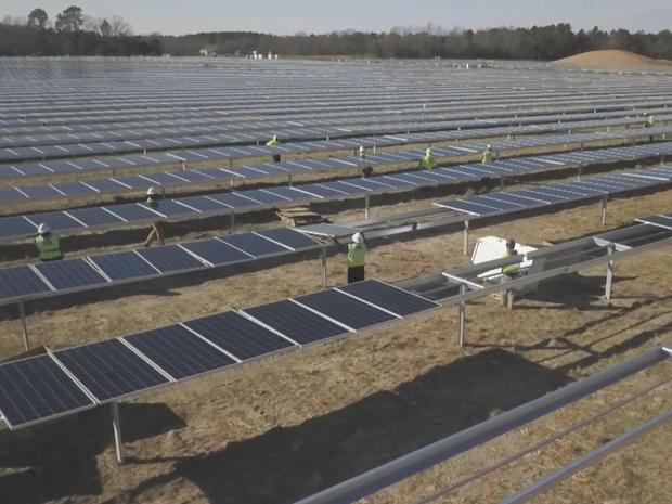 installing-solar-panels-at-solar-farm-in-south-carolina.jpg