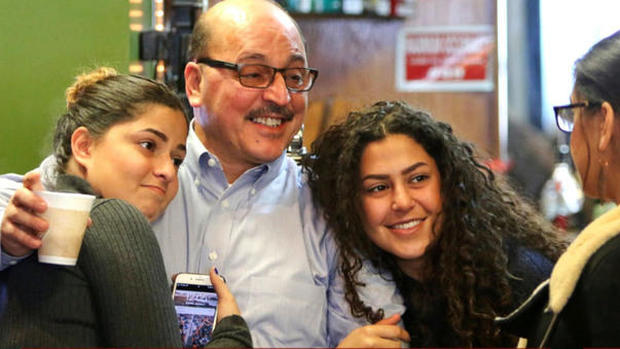 Businessman Amer Adi Othman, known as Al Adi, second from left, stands with his daughters in Youngstown, Ohio, Jan. 2, 2018.