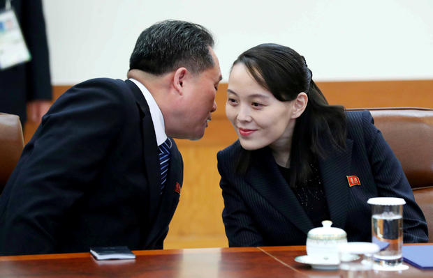 Ri Son-kwon, chairman of the Committee for the Peaceful Reunification of the Fatherland whispers to Kim Yo Jong, the sister of North Korea's leader Kim Jong Un before their meeting at the Presidential Blue House in Seoul