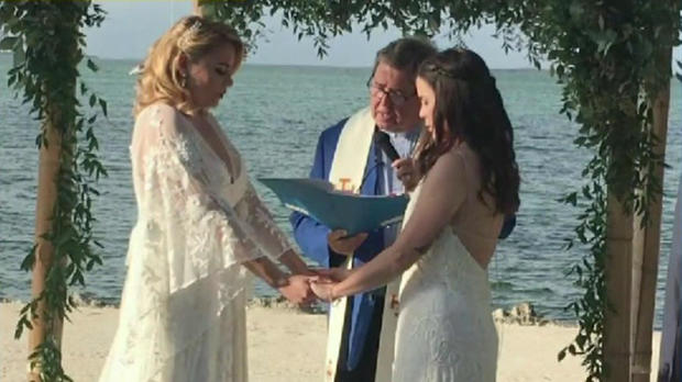 Miami teacher Jocelyn Morffi and her wife are seen at their wedding in this picture provided to CBS station WFOR-TV by Beatriz Gaviria Lopez.