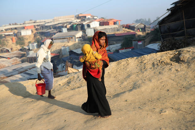 Rohingya refugees walk at Jamtoli camp in the morning in Cox's Bazar
