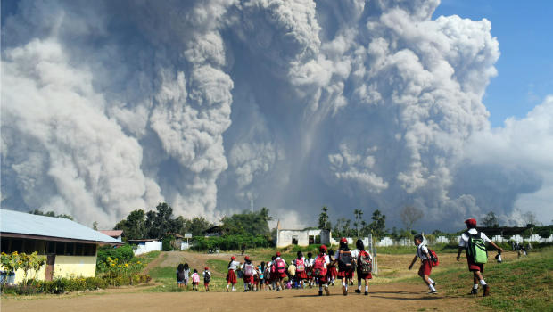 Mount Sinabung: Massive volcanic eruption 'turned day into night'