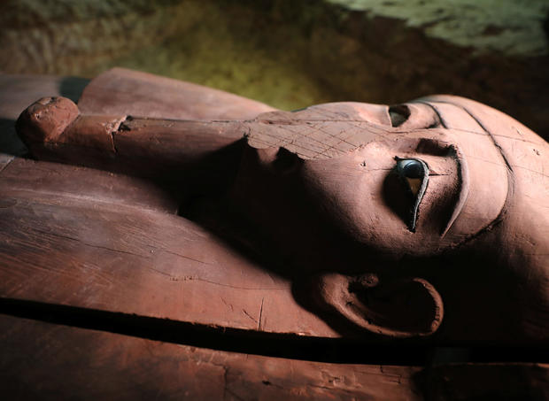 A wooden coffin inside the recently discovered burial site in Minya