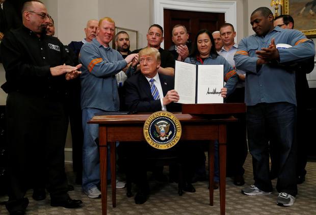 donald trump signs tariffs