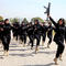 Female members of police commando march during a ceremony on International Women's Day, at the police headquarters in Islamabad