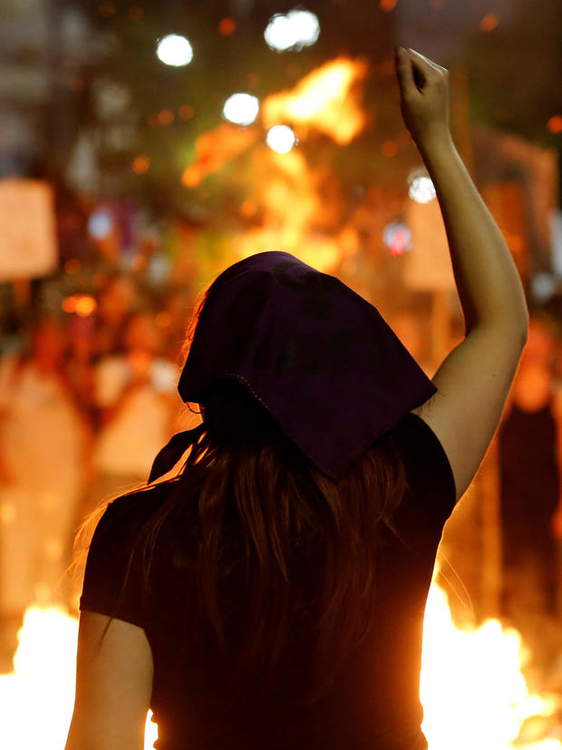 A woman participates in a demonstration as part of International Women's Day in Montevideo