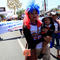 An activist carries her son during a march to mark International Women's Day in Managua