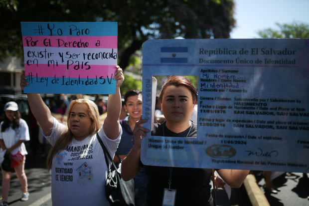 Activist and members of the LGBTQ community participate in a march to call for an end to violence against women during International Women's Day in San Salvador