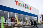 Customers walk in front of the Toys R Us store at Saint-Sebastien-sur-Loire near Nantes