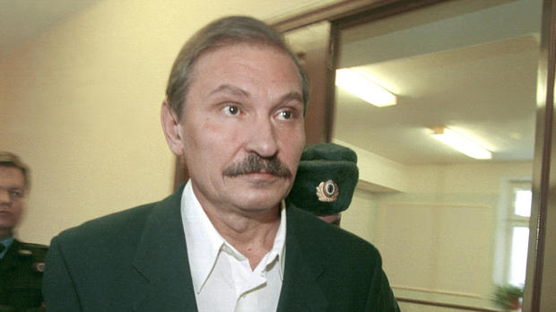 Nikolai Glushkov, ex-deputy director general of flagship Russian airline Aeroflot, leaves court escorted by police officers after a judge refused to release him on bail in Moscow Dec. 19, 2000.