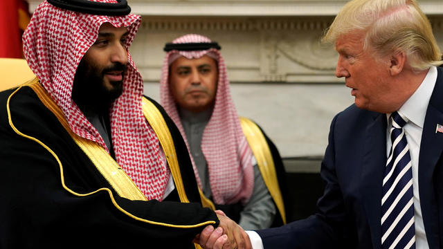 U.S. President Donald Trump shakes hands with Saudi Arabia's Crown Prince Mohammed bin Salman in the Oval Office at the White House in Washington