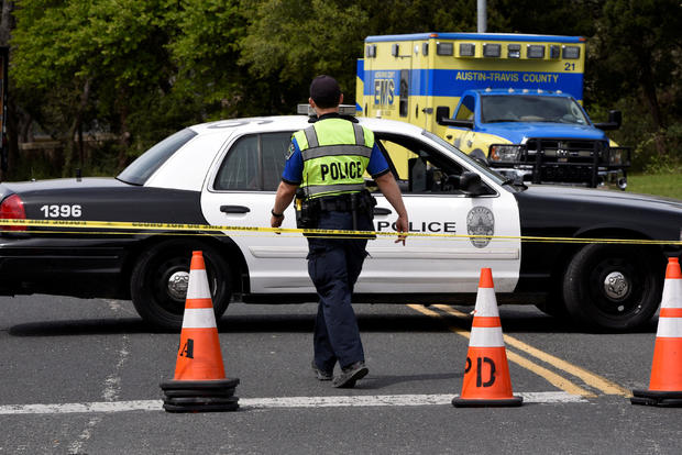 Members of the Austin Police Department block off part of Republic of Texas Boulevard following an explosion in Austin, Texas, March 19, 2018.