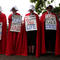 """Activists wear red robes and white bonnets based on """"The Handmaid's Tale"""" before the """"March for Our Lives"""", an organized demonstration to end gun violence, in downtown Houston"""