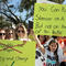 """People and students hold signs while rallying in the street during the """"March for Our Lives"""" demanding stricter gun control laws at the Miami Beach Senior High School, in Miami"""