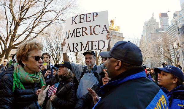 """A man holds an anti-gun control sign during a """"March For Our Lives"""" demonstration demanding gun control in New York City"""