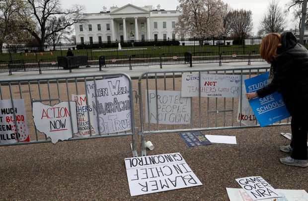 """People leave their leftover signs outside of the White House after students and gun control advocates held the """"March for Our Lives"""" event demanding gun control after recent school shootings at a rally in Washington"""