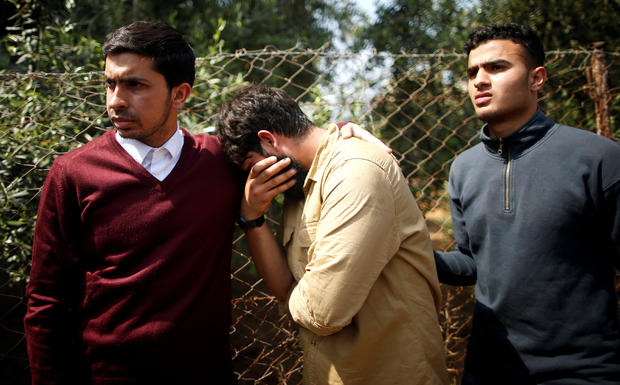 Colleagues of Palestinian journalist Yasser Murtaja, 31, who died of his wounds during clashes at the Israel-Gaza border on Friday, mourn during his funeral in Gaza city