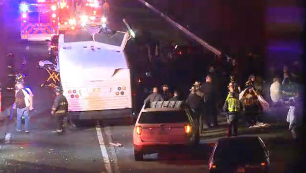 Dozens of students hurt when bus roof sheared off in overpass crash