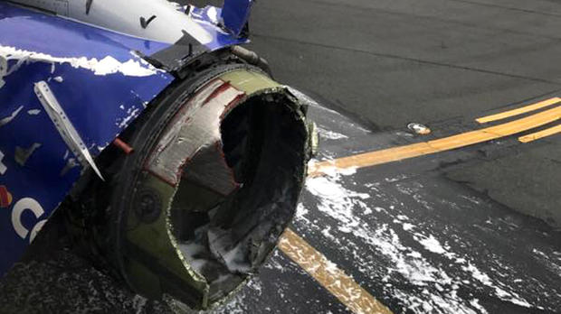 An engine on Southwest Airlines Flight 1380 is seen after the Boeing 737 made an emergency landing at Philadelphia International Airport on April 17, 2018.