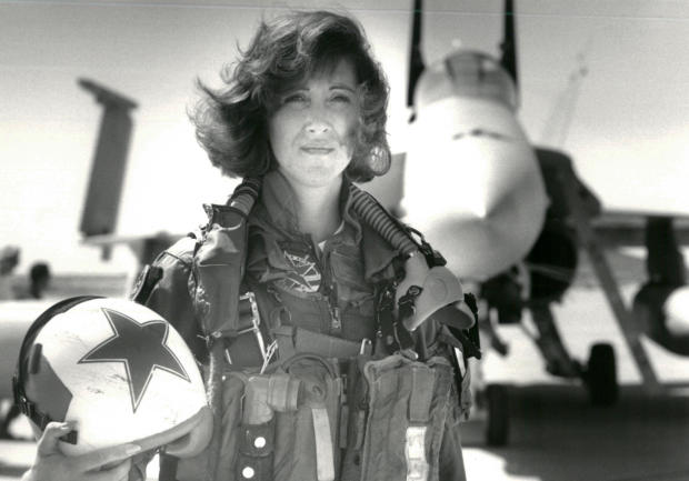 U.S. Navy Lt. Tammie Jo Shults poses in front of a Navy F/A-18A in this 1992 photo released in Washington April 18, 2018.