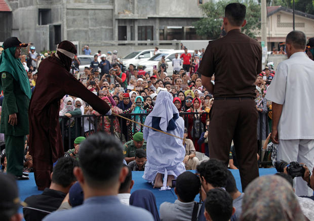 An Indonesian woman is publicly caned for prostitution in Banda Aceh