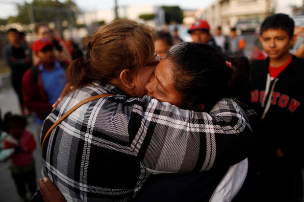 A member of a migrant caravan from Central America hugs an evangelical faithful as they pray in preparation for an asylum request in the U.S., in Tijuana