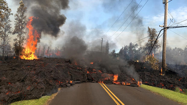 Lava advances along a street near a fissure in Leilani Estates, on Kilauea Volcano's lower East Rift Zone in Hawaii May 5, 2018.