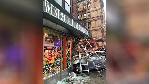 6 hurt when auto jumps curb, crashes into storefront in Chelsea