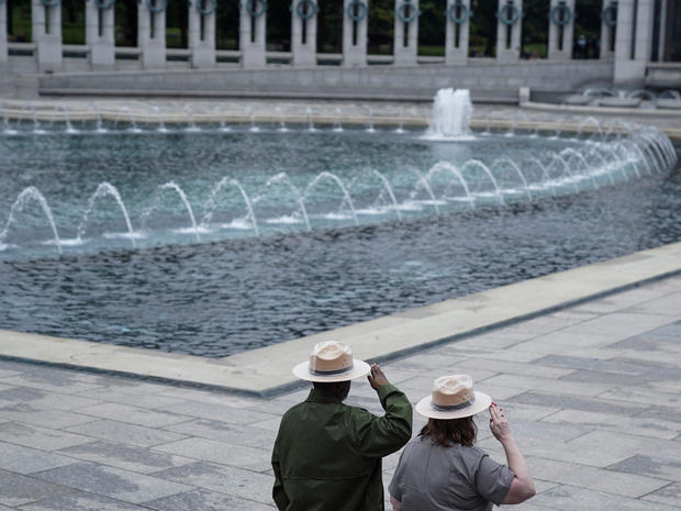 Participants gather for a Memorial Day Observance at the World War II Memorial in Washington