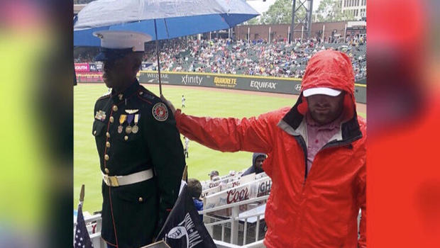 Viral photo shows fan holding umbrella over JROTC cadet in rain