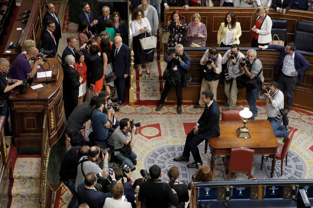Spain's new Prime Minister and Socialist party (PSOE) leader Pedro Sanchez poses for photographers after a motion of no confidence vote at parliament in Madrid