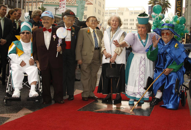 "Munchkins from the 1939 movie classic ""The Wizard of Oz"" pose with their new star on the Hollywood Walk of Fame during their induction ceremony Nov. 20, 2007, in front of Grauman's Chinese Theatre in Hollywood, California. From left to right are Clarence"