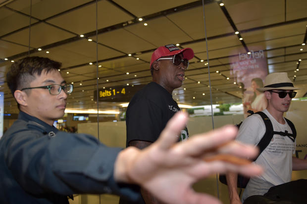 Retired American professional basketball player Dennis Rodman arrives at Changi International airport ahead of the U.S.-North Korea summit in Singapore on June 11, 2018.