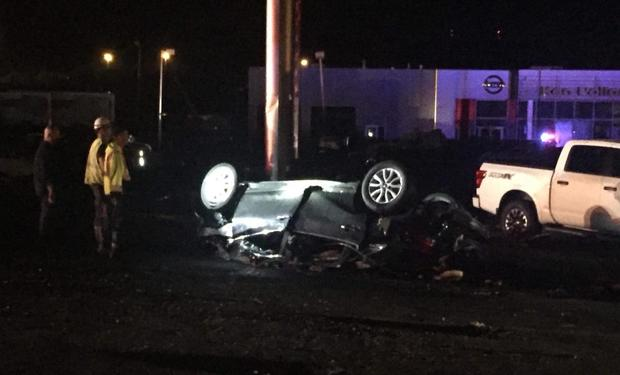 Car is seen after being overturned by possible tornado in Wilkes-Barre Pennsylvania on night