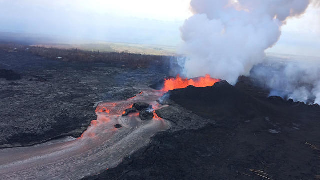 Lava fragments falling from lava fountains at fissure 8 are building a cinder-and-spatter cone around the erupting vent during ongoing eruptions of the Kilauea Volcano in Hawaii