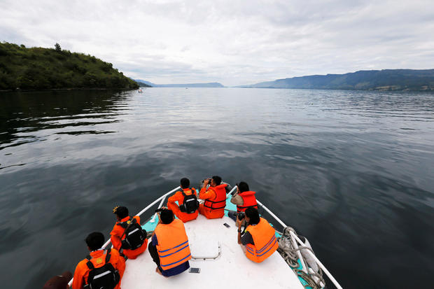 Search and rescue personnel look for missing passengers from Monday's ferry accident at Lake Toba in Simalungun