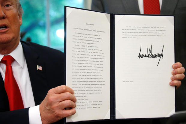 U.S. President Trump displays an executive order on immigration policy at the White House in Washington