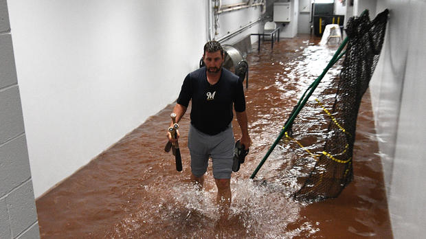 Marcus Hanel, No. 55 of the Milwaukee Brewers, walks through a flooded hallway outside of the dugout during a rain delay in a game against the Pittsburgh Pirates at PNC Park on June 20, 2018, in Pittsburgh, Pennsylvania.