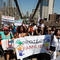 "Demonstrators march on Brooklyn Bridge during ""Keep Families Together"" march to protest Trump administration's immigration policy in New York"
