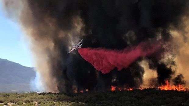 An air tanker drops retardant on the so-called Benton Fire near the intersection of Benton Road and Crams Corner Drive in this image on social media in Anza California