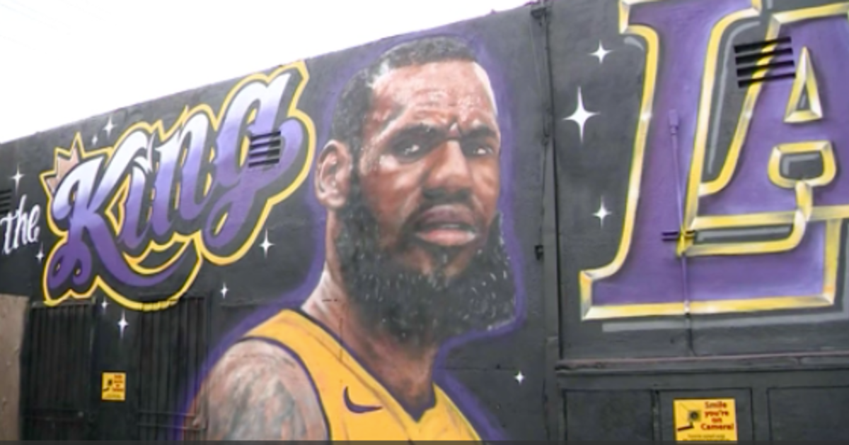 LeBron James mural vandalized, restored in Los Angeles - CBS News