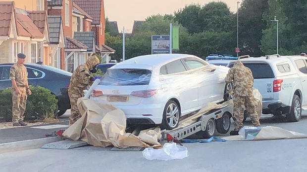 Personnel arrange the transportation of a car in relation to the ongoing nerve-agent incident in Amesbury, in Swindon