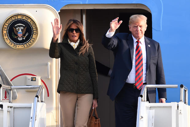 President Trump and first lady Melania Trump wave as they disembark Air Force One at Prestwick Airport, south of Glasgow, Scotland, on July 13, 2018, on the second day of the Trumps' U.K. visit.